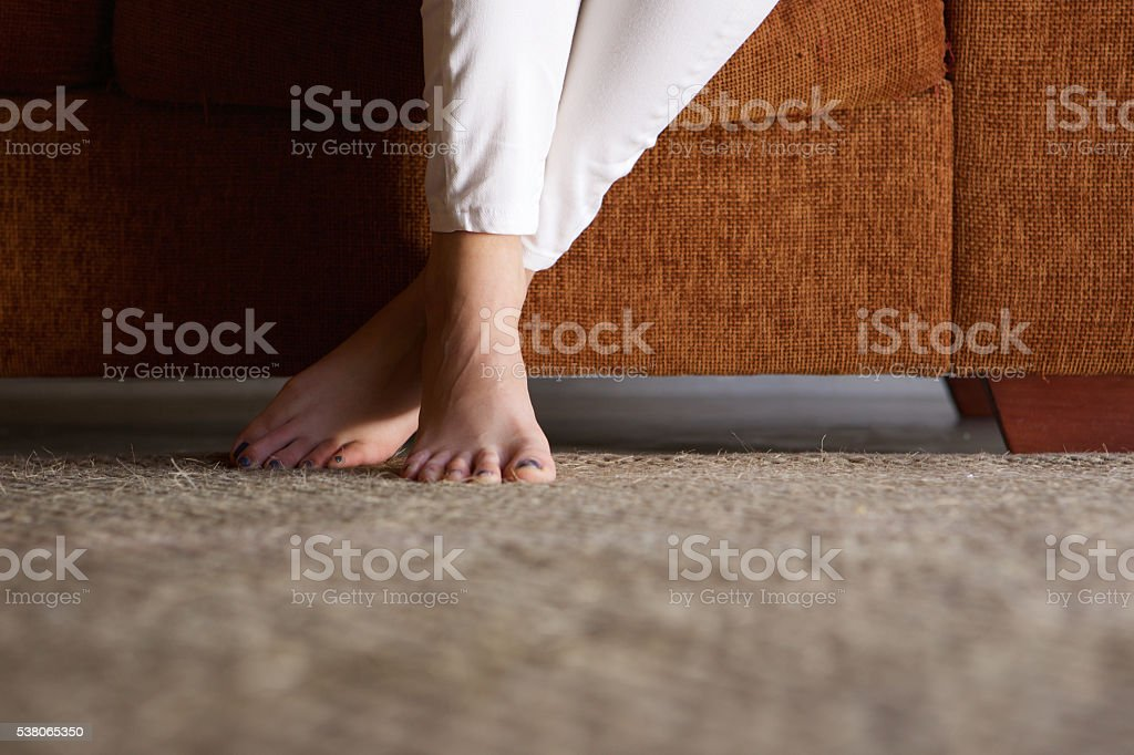 Woman feet on floor at home stock photo