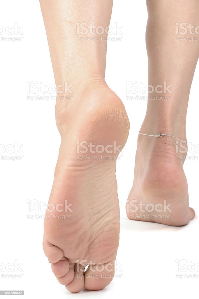 Woman  feet over white background royalty-free stock photo