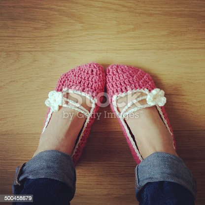A pair of crocheted bed slippers