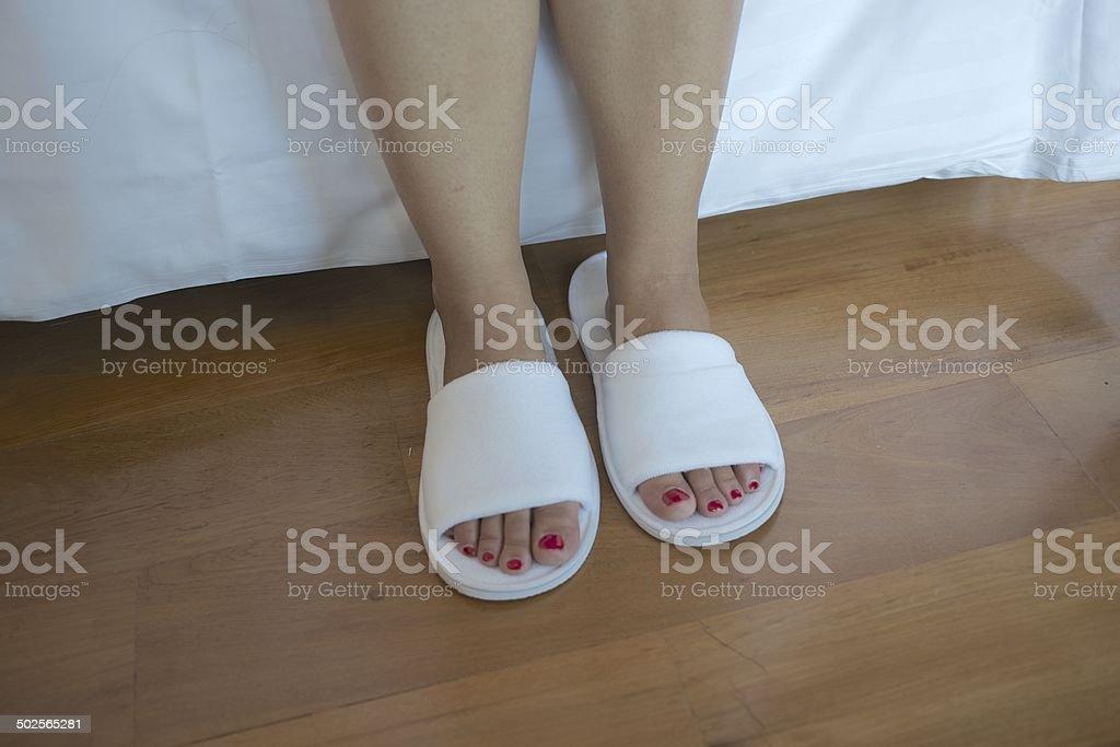Woman feet with white slipper royalty-free stock photo