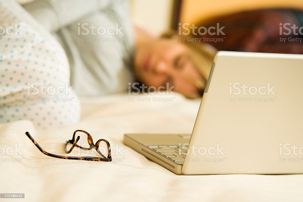 A woman fell asleep because she was working too hard  stock photo