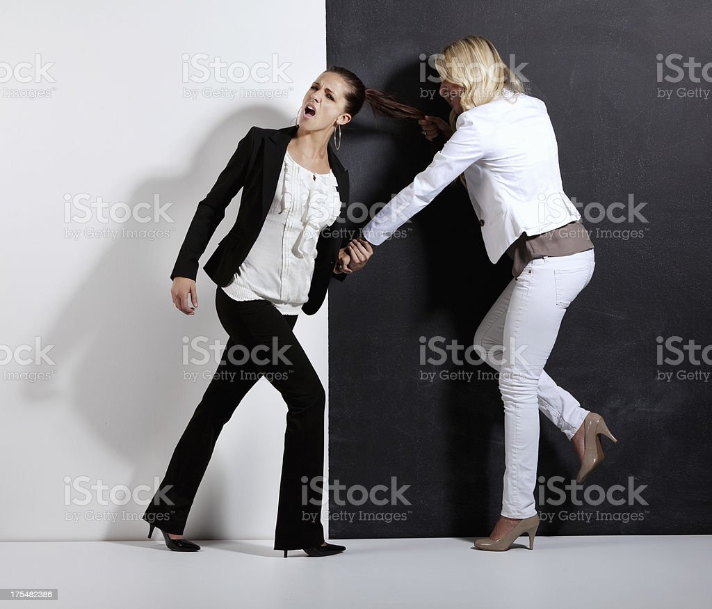Woman fighting with another one stock photo