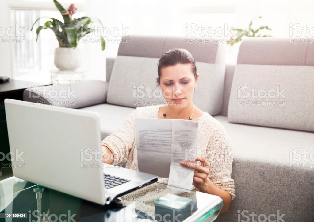 Woman Filing Income Tax Online stock photo
