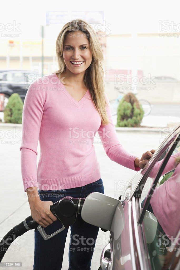 Woman  filling car with gas royalty-free stock photo