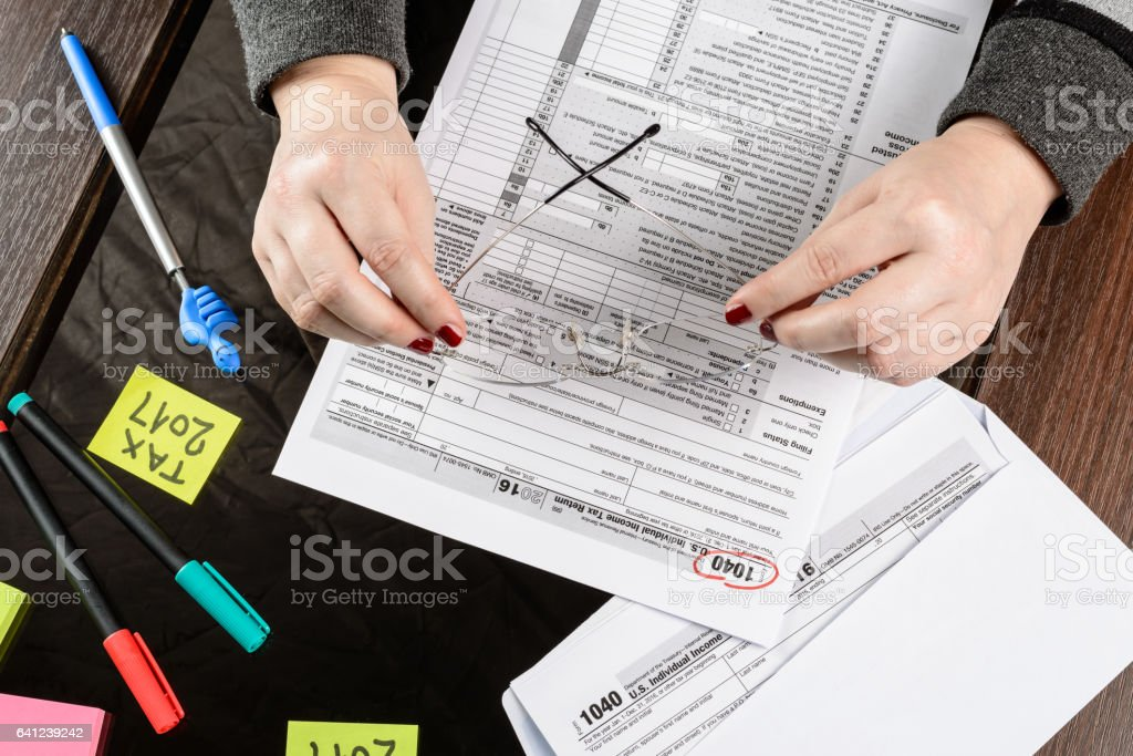 Woman Fills The Tax Form Working With Tax Documentsform 1040