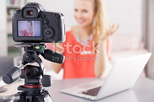 istock Woman filming her broadcast 637118458