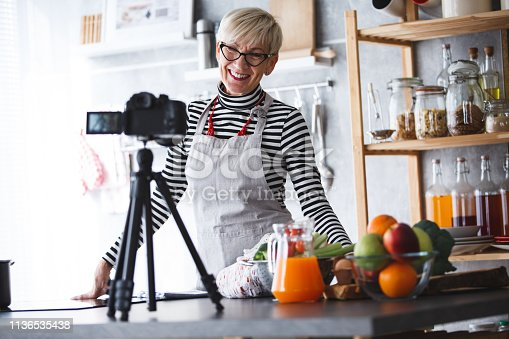 Woman filming video for her food channel.