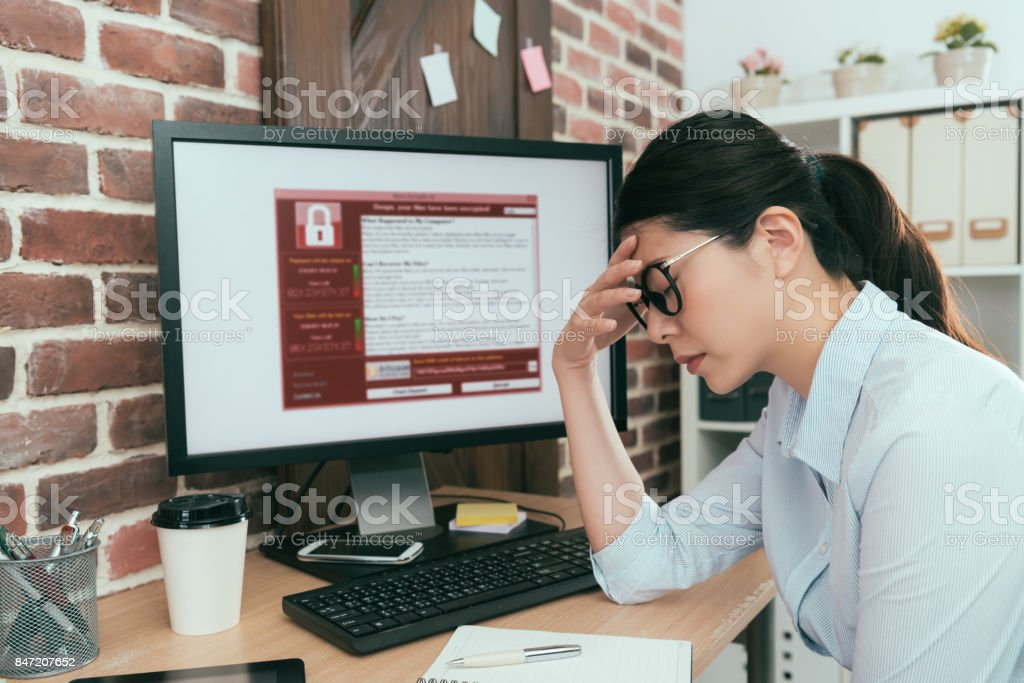 woman finding computer getting virus attack stock photo