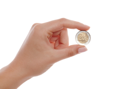 two euro in woman hand on white background