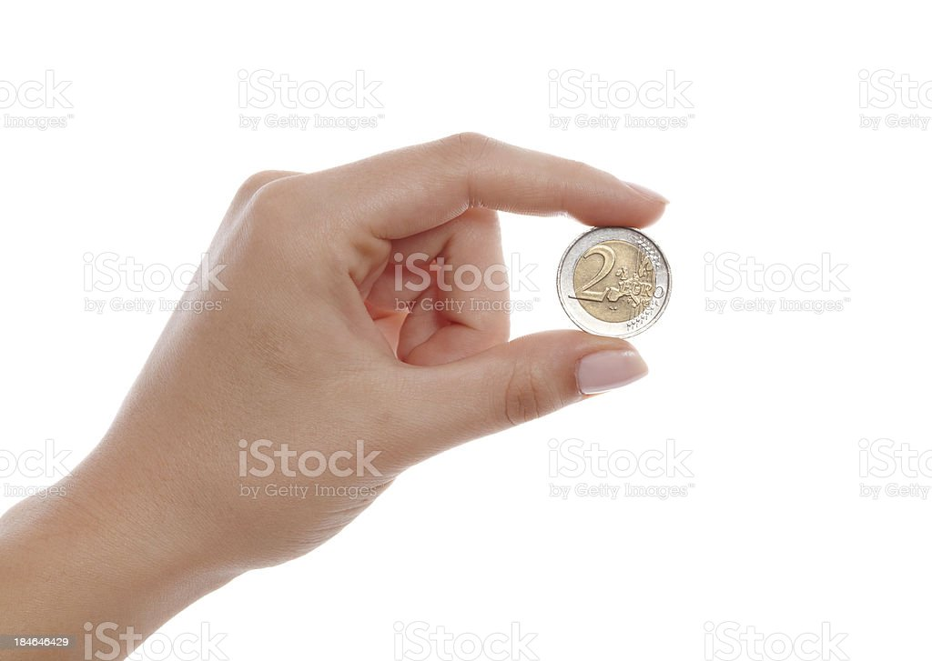 Woman finger holding two euro coin isolated on white stock photo