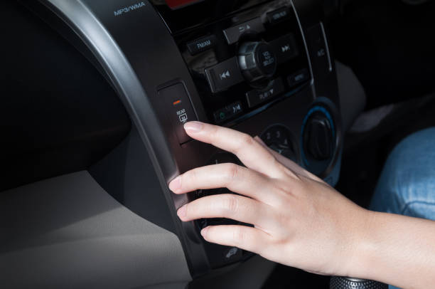 woman finger pressing button defrost detail on a car's dashboard - defrost stock pictures, royalty-free photos & images