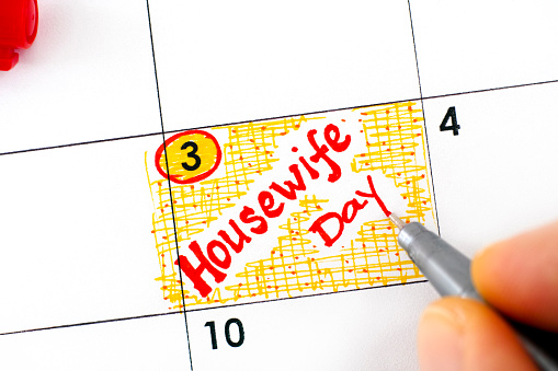 Woman Fingers With Pen Writing Reminder Housewife Day In Calendar November 03 Stock Photo - Download Image Now