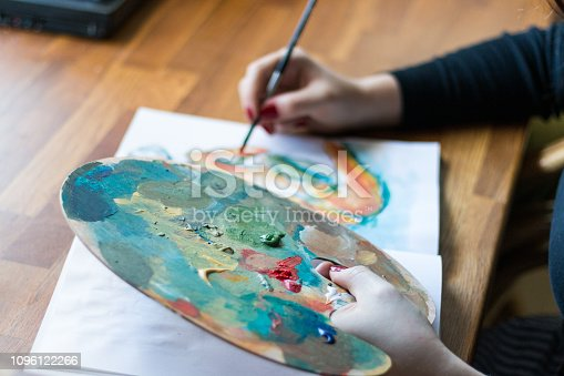istock Woman finishing a painting 1096122266