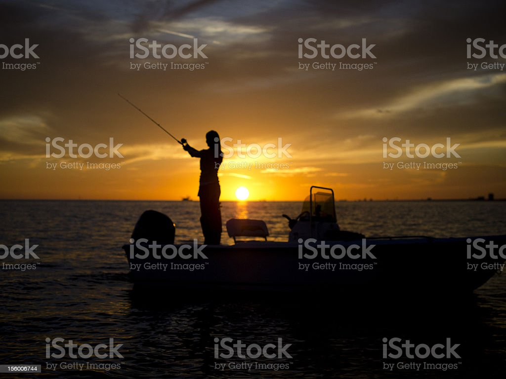 Woman fishing off boat in Gulf of Mexico stock photo
