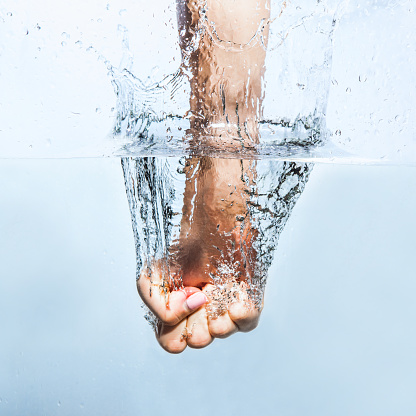 istock Woman fist through the water 819179048