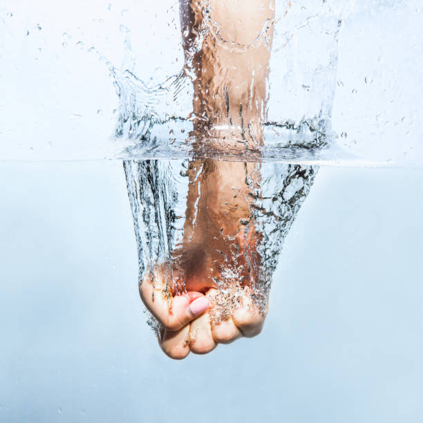 Woman fist through the water Fist punching water splash sopaatervinning stock pictures, royalty-free photos & images