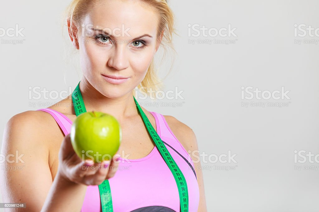 woman fit girl with measure tape and apple fruit foto royalty-free