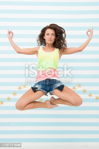 istock Woman fit slim lady posing as meditating while jump mid air. Healthy lifestyle keep you in good mood. Lady fit healthy look good. Fitness lifestyle benefits and advantages. Yoga meditating skill 1157711548