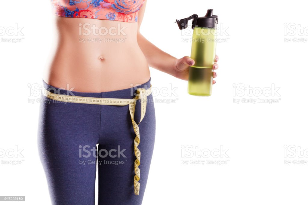 woman fitness exercise holding natural water at plastic bottle. Sport and healthy lifestyle concept stock photo