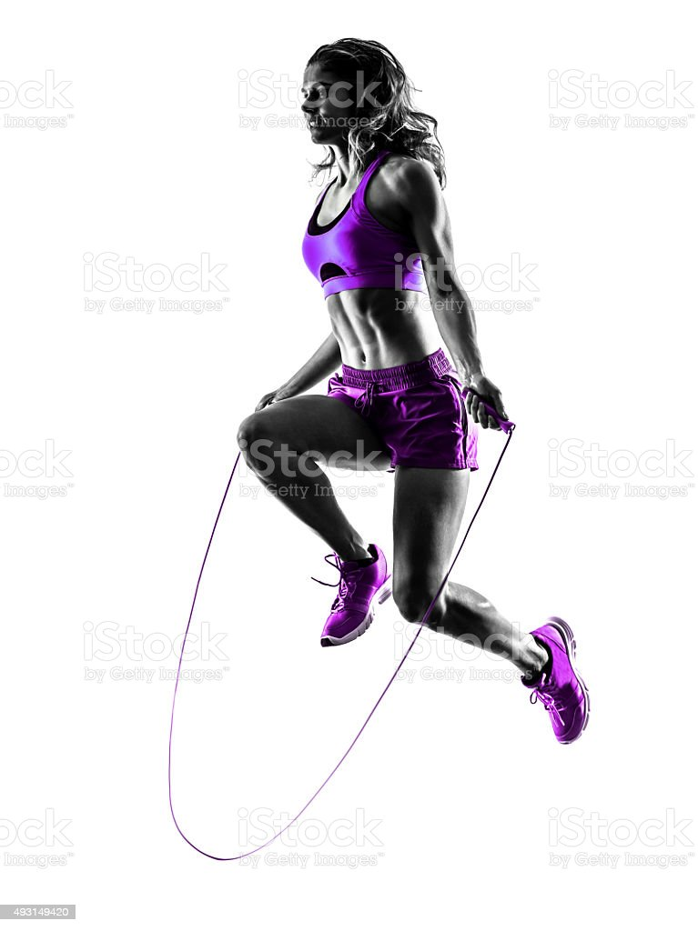 woman fitness Jumping Rope exercises silhouette stock photo