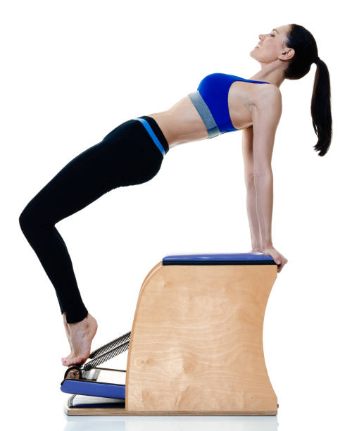 Woman Pilates Chair Exercises Fitness Stock Photo: Top Pilates Chair Stock Photos, Pictures And Images