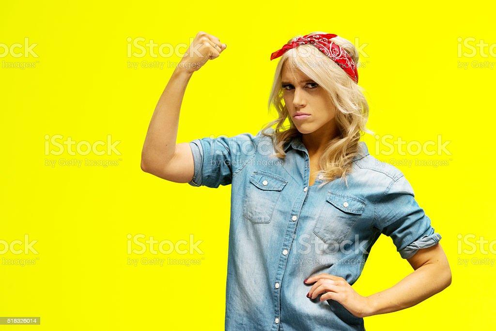 Woman flexing muscle stock photo
