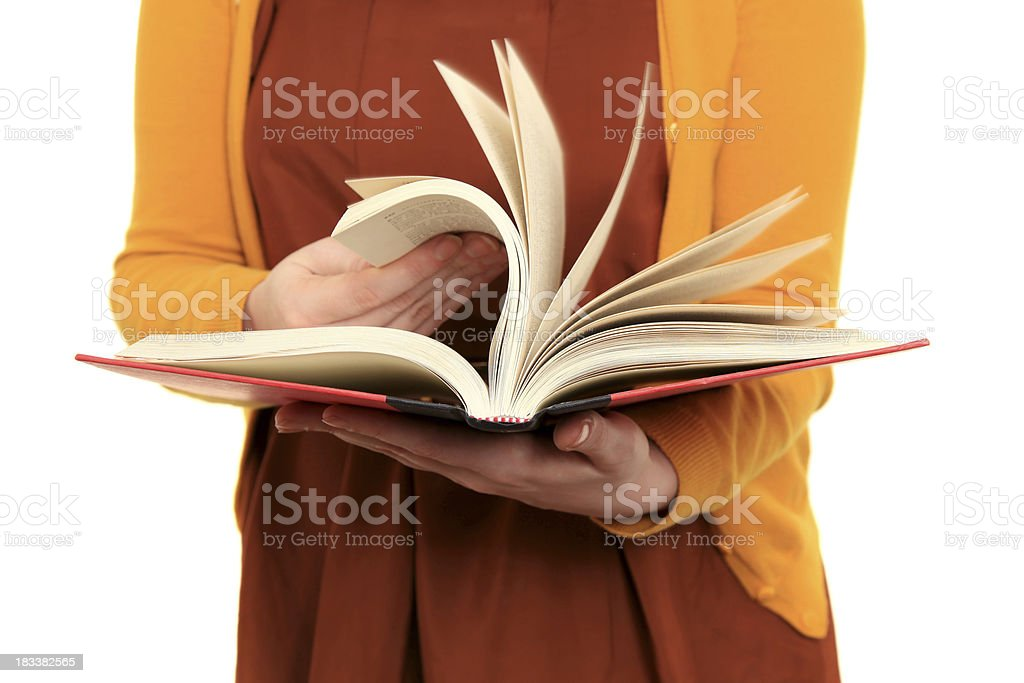 Woman flips through pages of book royalty-free stock photo