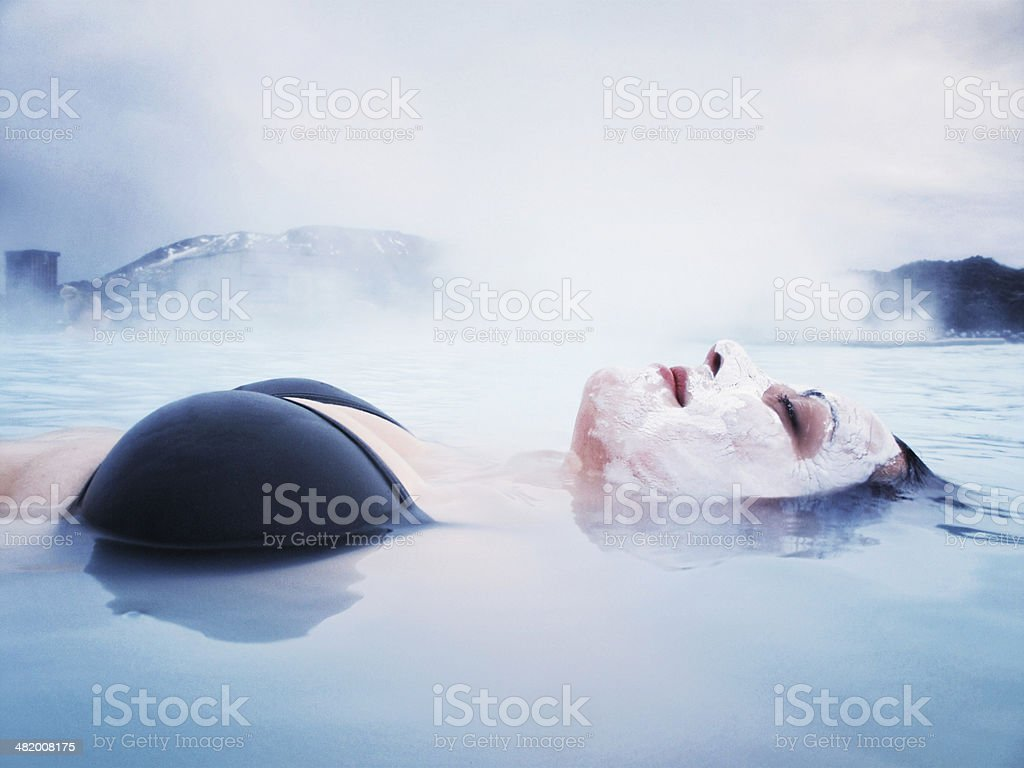 Woman Floating in the Blue Lagoon, Iceland stock photo