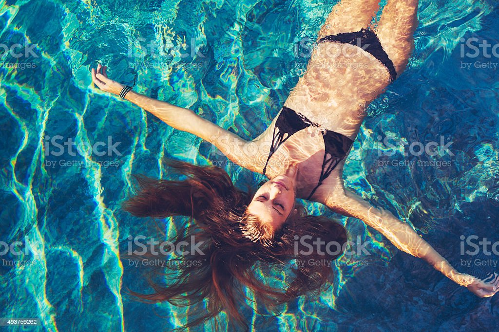 Woman Floating in Water Relaxing stock photo