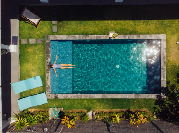 Woman floating on pool at Bali Woman floating on pool at Bali lesser sunda islands stock pictures, royalty-free photos & images