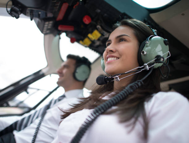 Woman flying a helicopter stock photo
