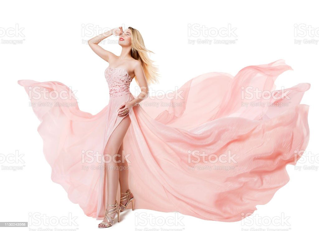 Woman Flying Pink Dress, Fashion Model in Long Waving Gown, Fluttering Fabric on White stock photo