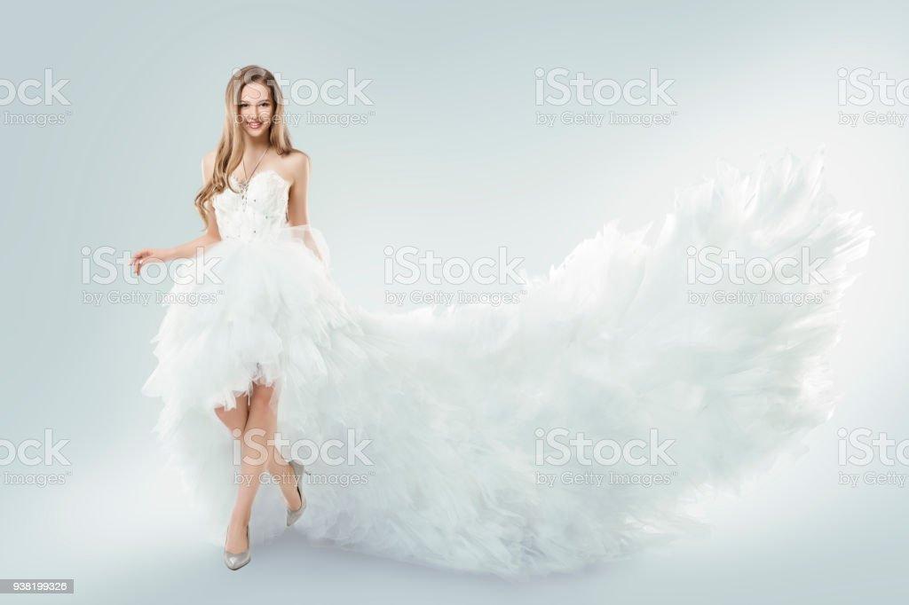 Woman Flying White Dress, Elegant Fashion Model Fluttering Gown Train, Studio Beauty Portrait stock photo