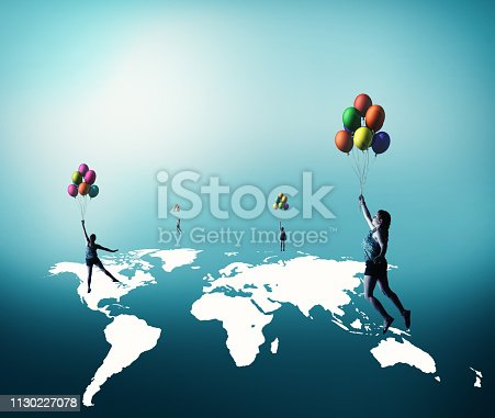 Woman flying with baloons over world map
