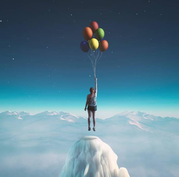 frau fliegt mit bunten luftballons in die nacht das konzept der vollendeten träume. - traumhaft stock-fotos und bilder