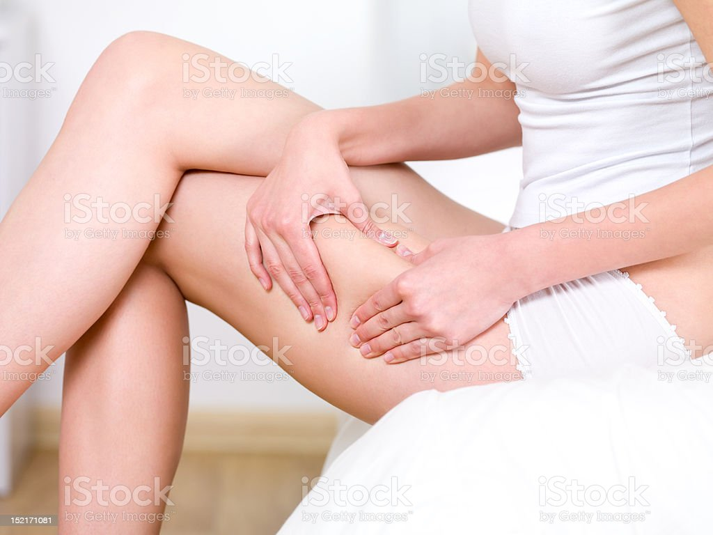 Woman folding skin on her hips stock photo
