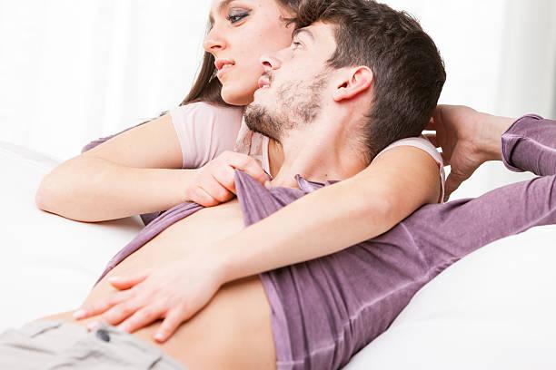 woman fondling belly of his man - tantra massage stock-fotos und bilder