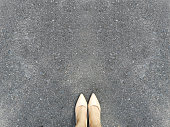 Woman Foot and Legs on Concrete Road, Beautiful Shoe Top View. Selfie of Feet in Fashion Nude High Heels Shoes Standing on Street from Above Background