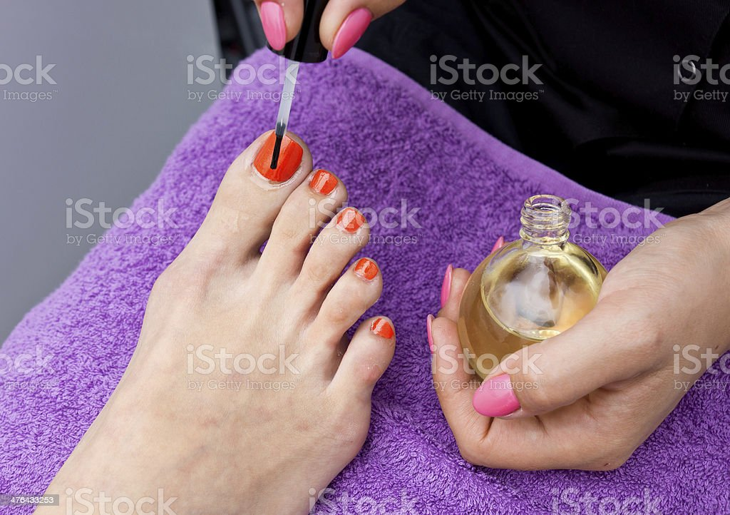 woman foot nail polishing in salon royalty-free stock photo