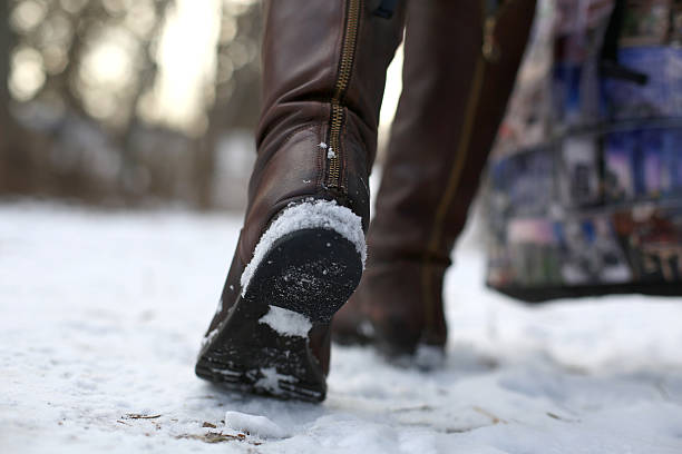 woman footing in snow stock photo