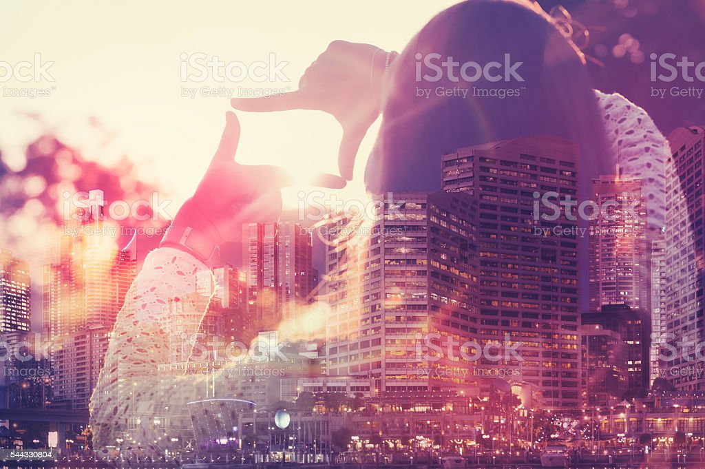 Woman framing the future. stock photo