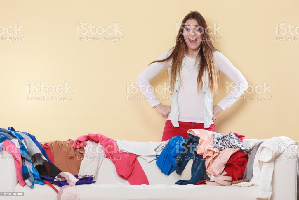 Woman freaking out in messy room home. stock photo