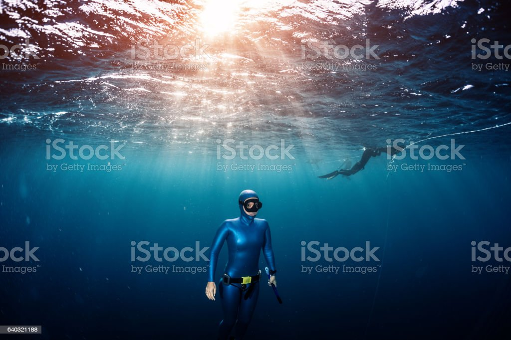 Woman free diver stock photo