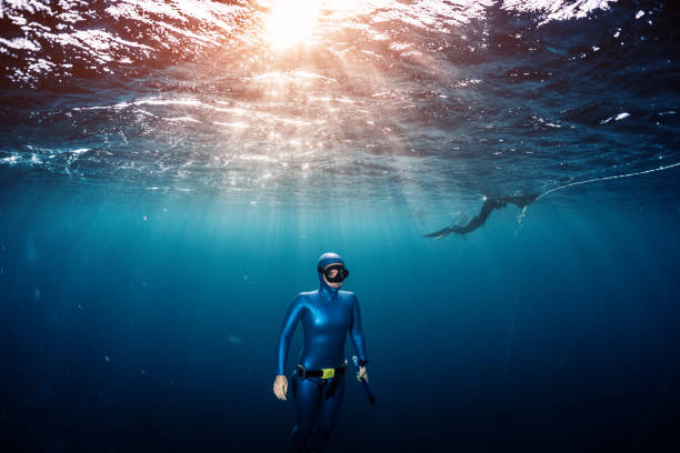 Woman free diver stock photo