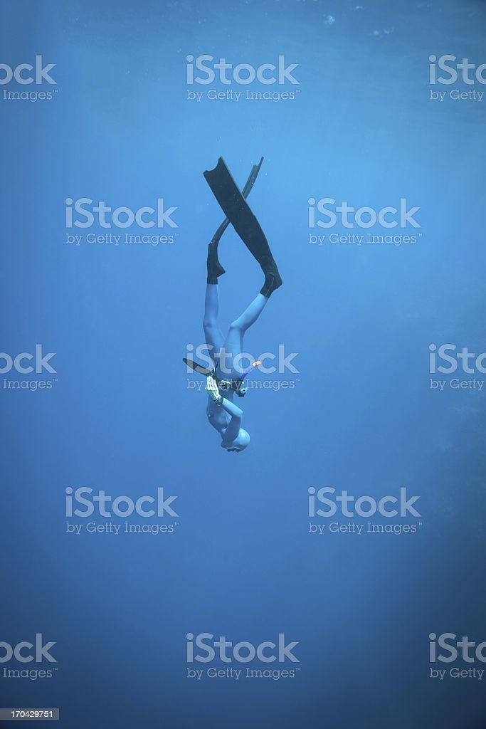 Woman freediving in the ocean More freediving shots: Athlete Stock Photo