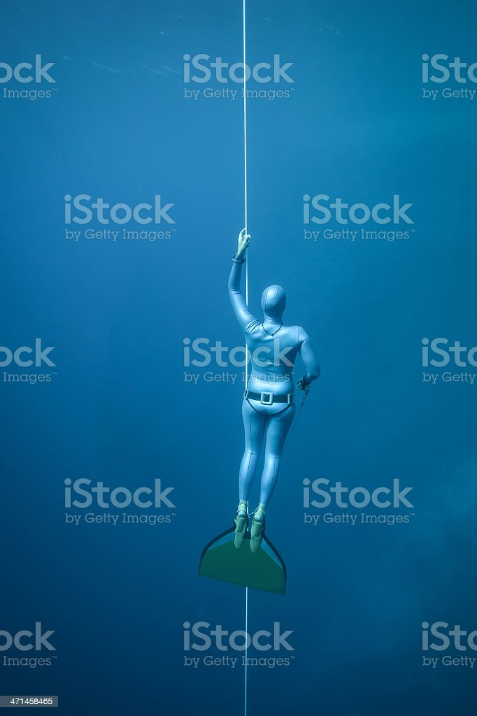 Woman freediving in the ocean royalty-free stock photo