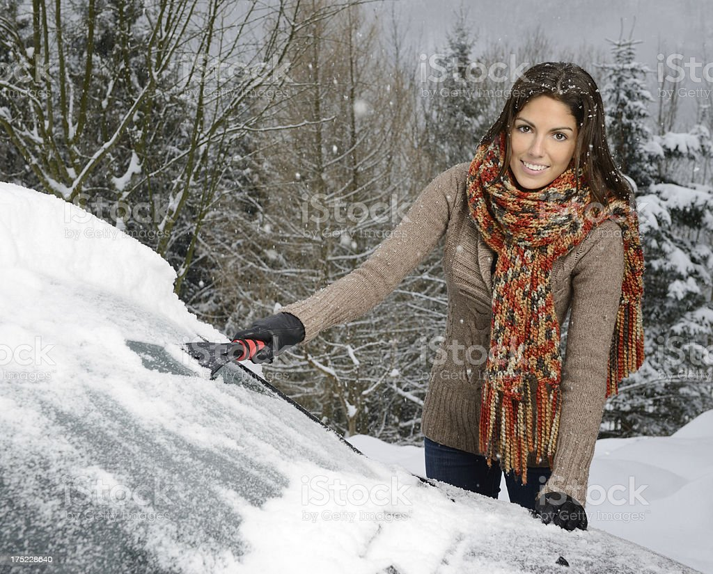 Woman freeing her car from Snow royalty-free stock photo