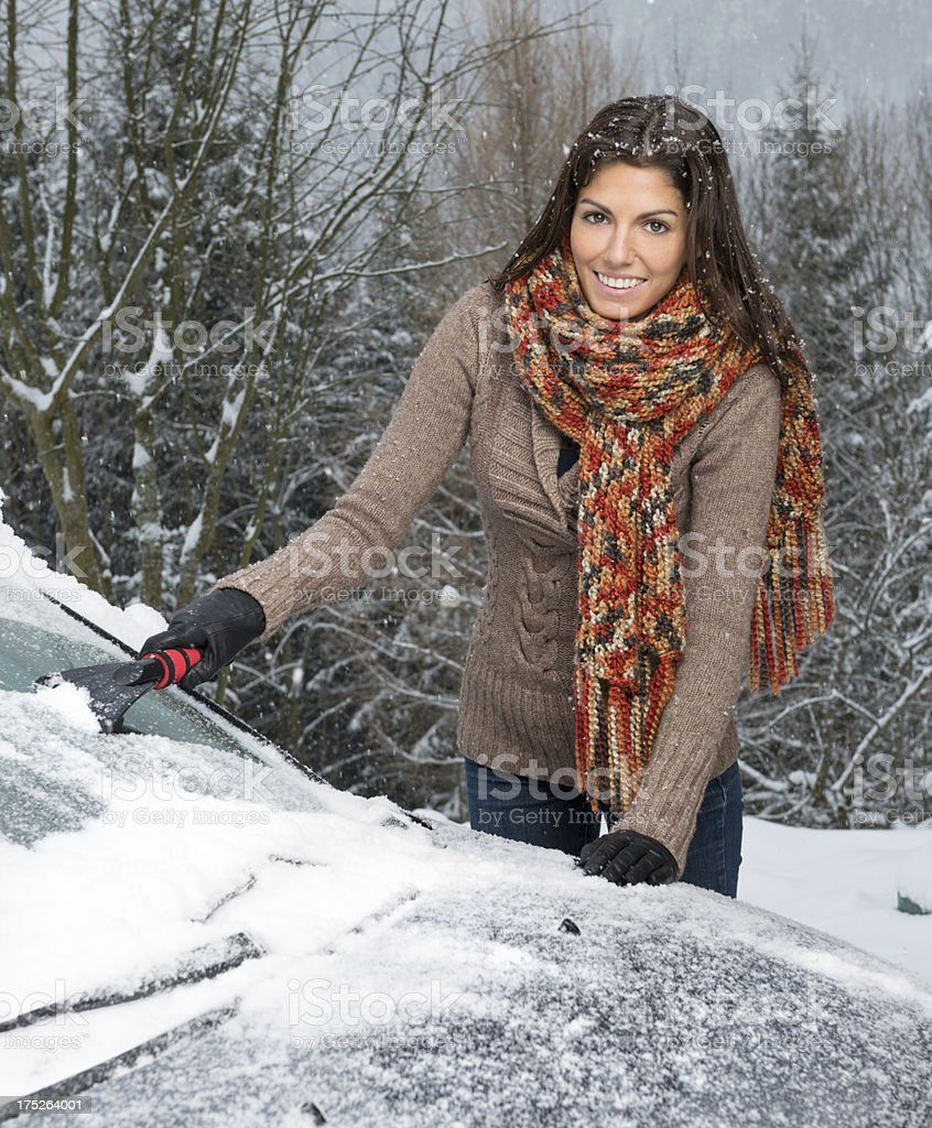 Woman freeing her car in a Snow Storm royalty-free stock photo