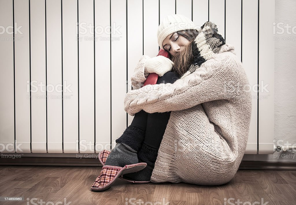 Woman freezing at home stock photo