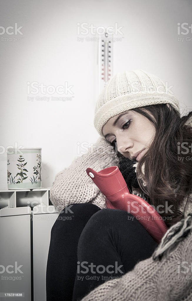 Woman freezing at home royalty-free stock photo